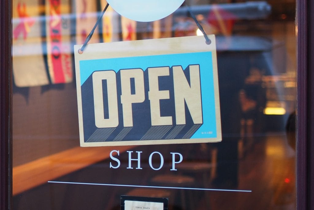business open sign hanging in a window