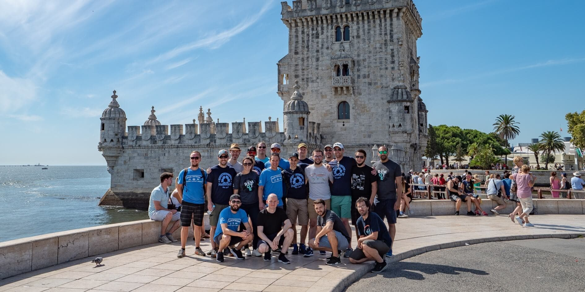 hubstaff team on annual retreat in front of tower belem