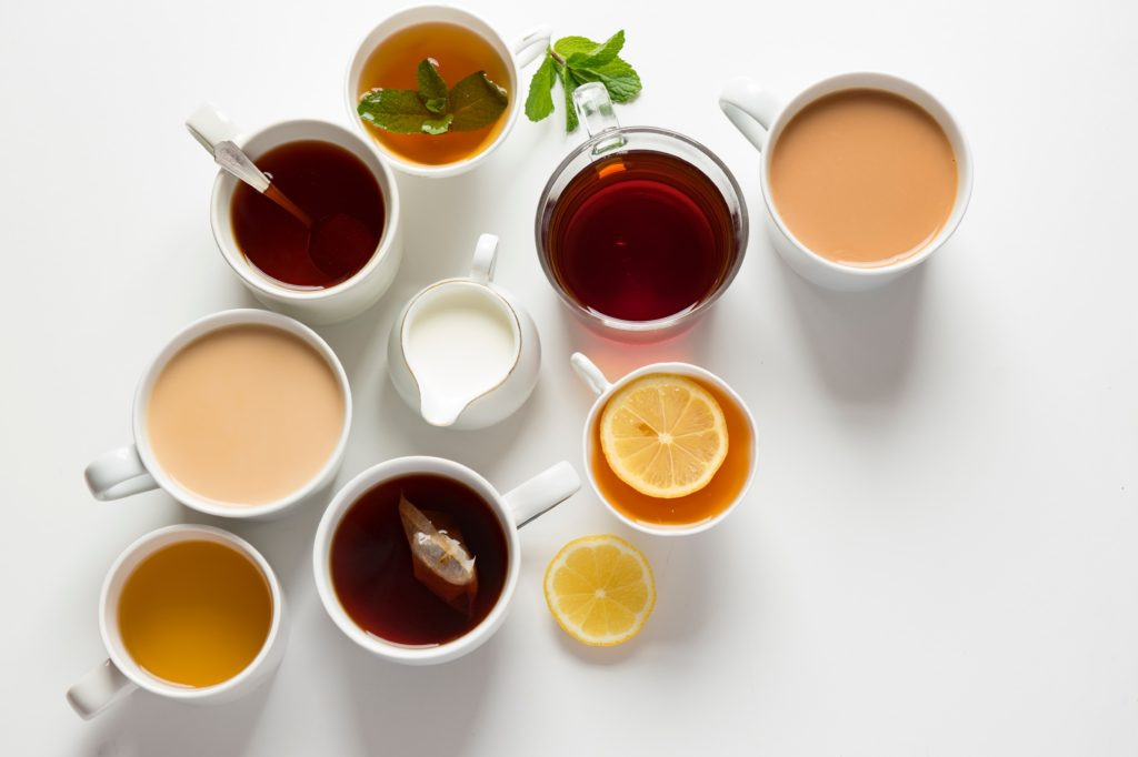 variety of cups filled with tea