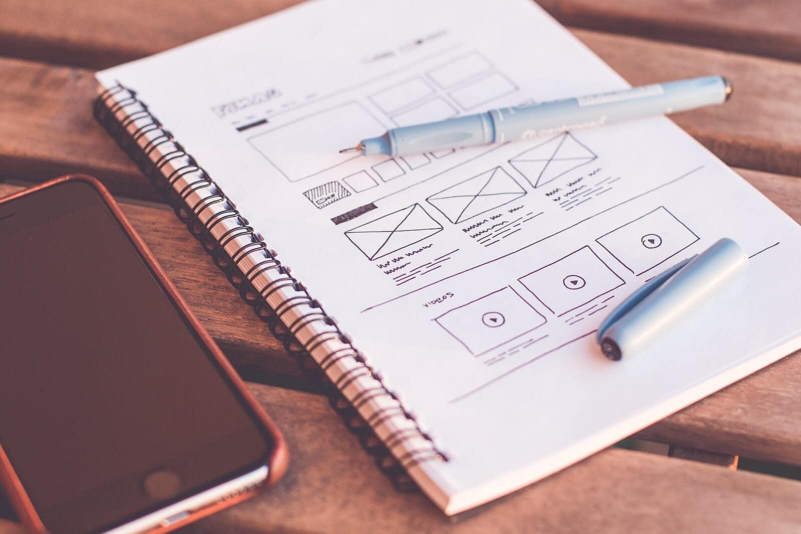 graphic designer desk with notebook sketches