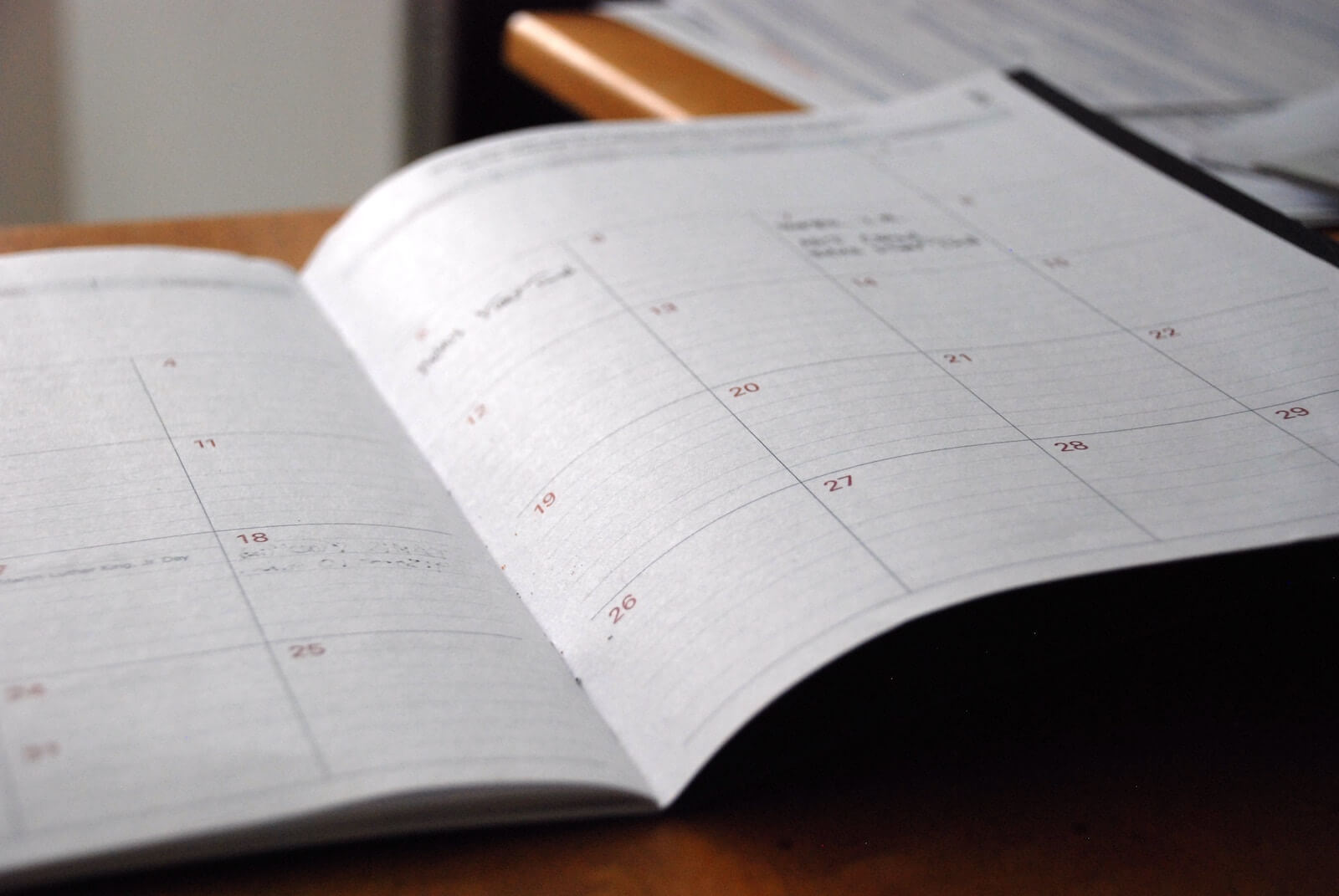 paper schedule book open with blank pages
