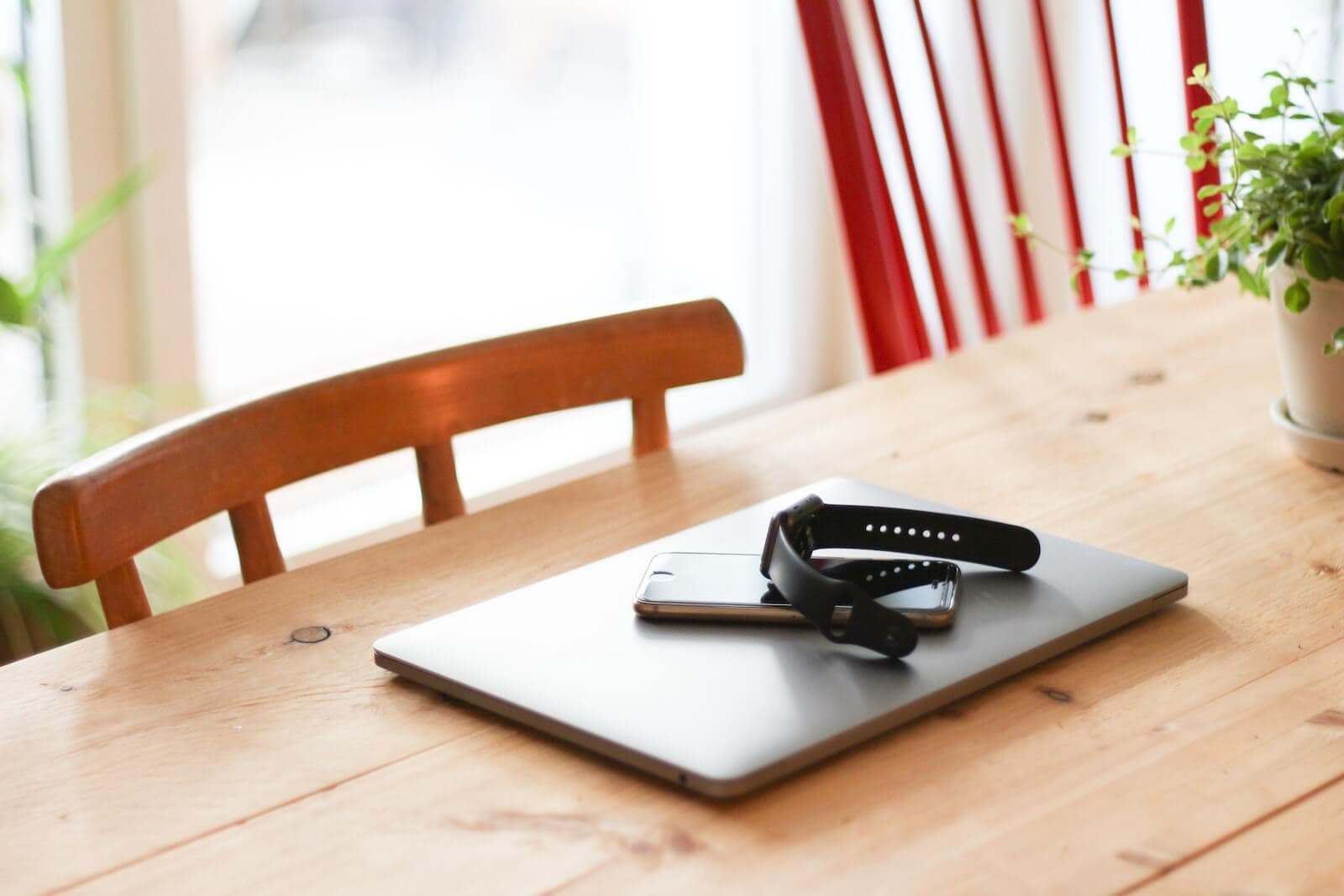 working from home at a kitchen table